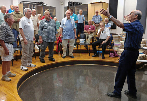 Director Jim Raspberry leads chorus rehearsal